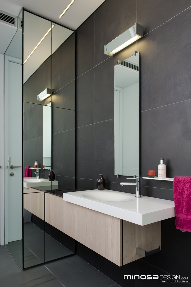Innovative use of space creates a seamless bathroom design for Narrow bathroom designs