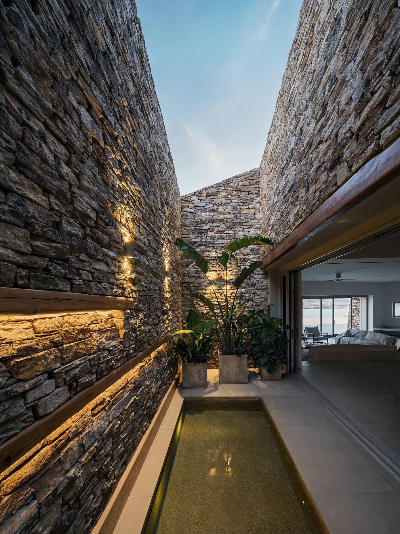 Encaved Stone Villa by Tsolakis Architects